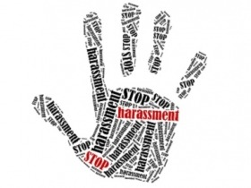 Image of hand with anti-harassment language
